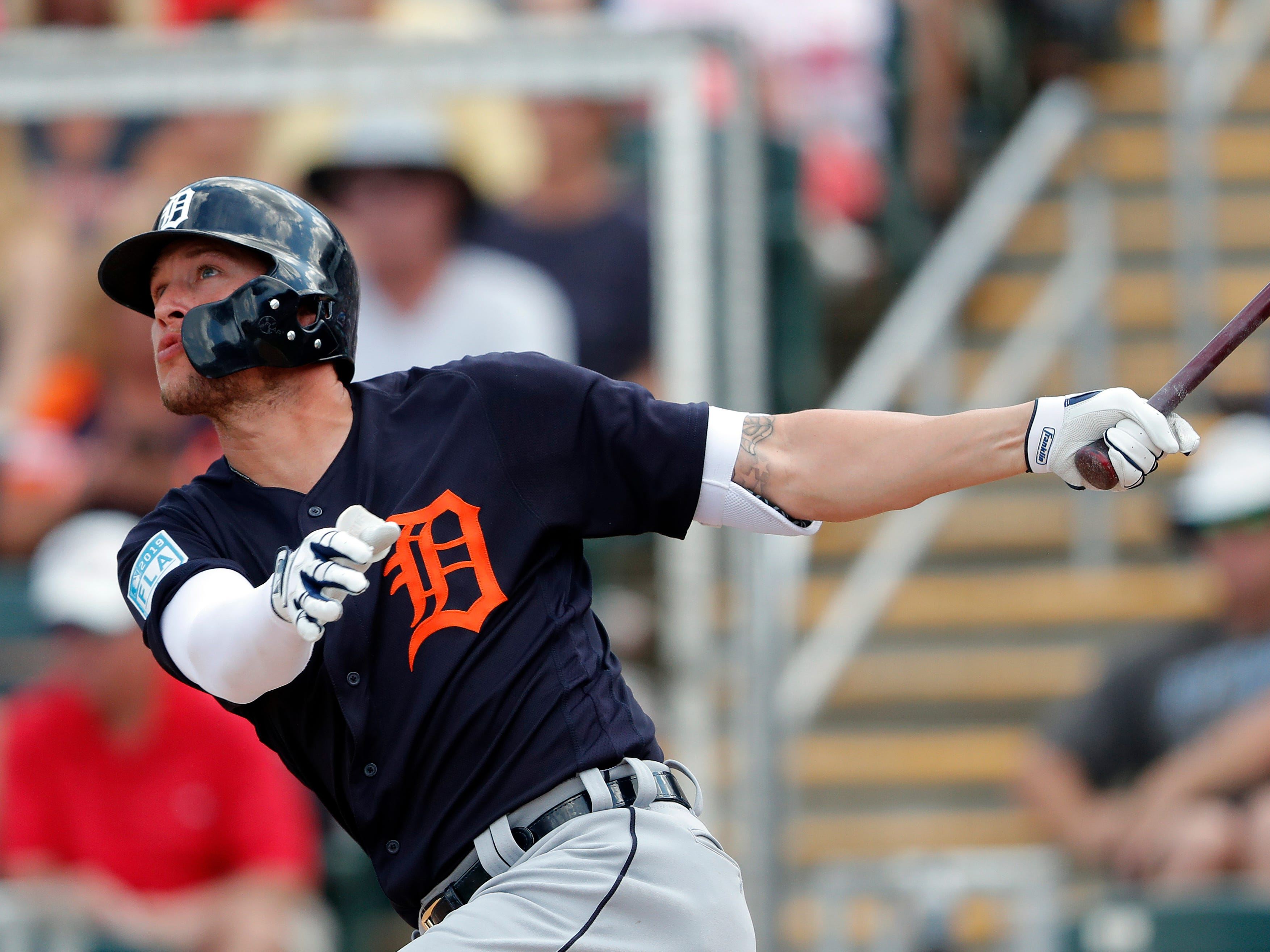 Detroit Tigers left fielder JaCoby Jones (21) follows through on a two-run home run in the fifth inning of a spring training baseball game against the Minnesota Twins Monday, March 11, 2019, in Fort Myers, Fla.