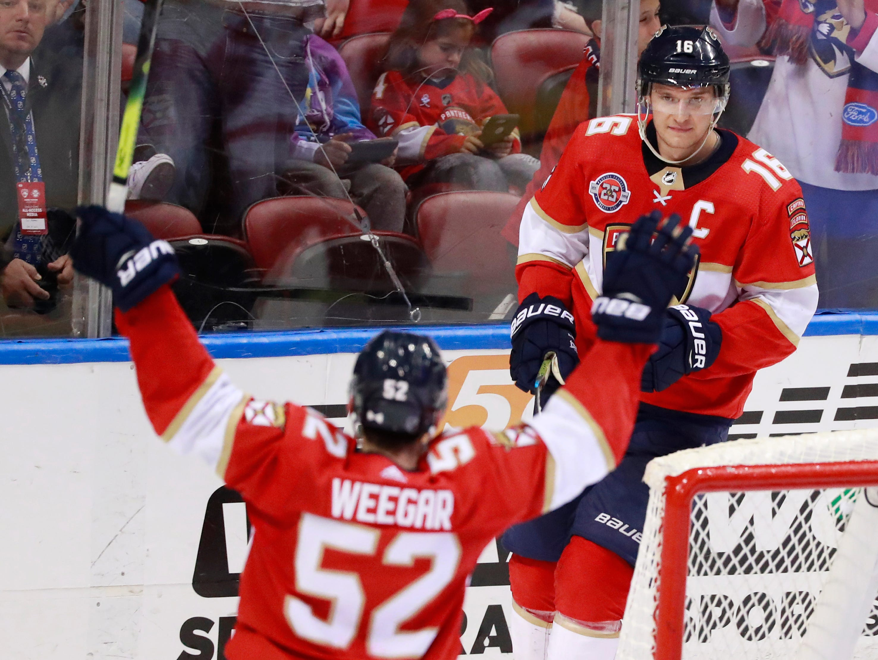 Florida Panthers defenseman MacKenzie Weegar (52) congratulates center Aleksander Barkov (16) after Barkov scored during the third period.