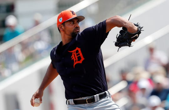 The Tigers' Tyson Ross delivers against the Twins on Monday.
