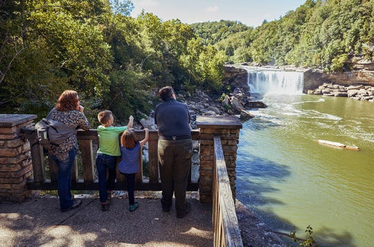 Visitors gather on the observation deck at Cumberland Falls State Resort Park in southeastern Kentucky. (parks.ky.gov/TNS)