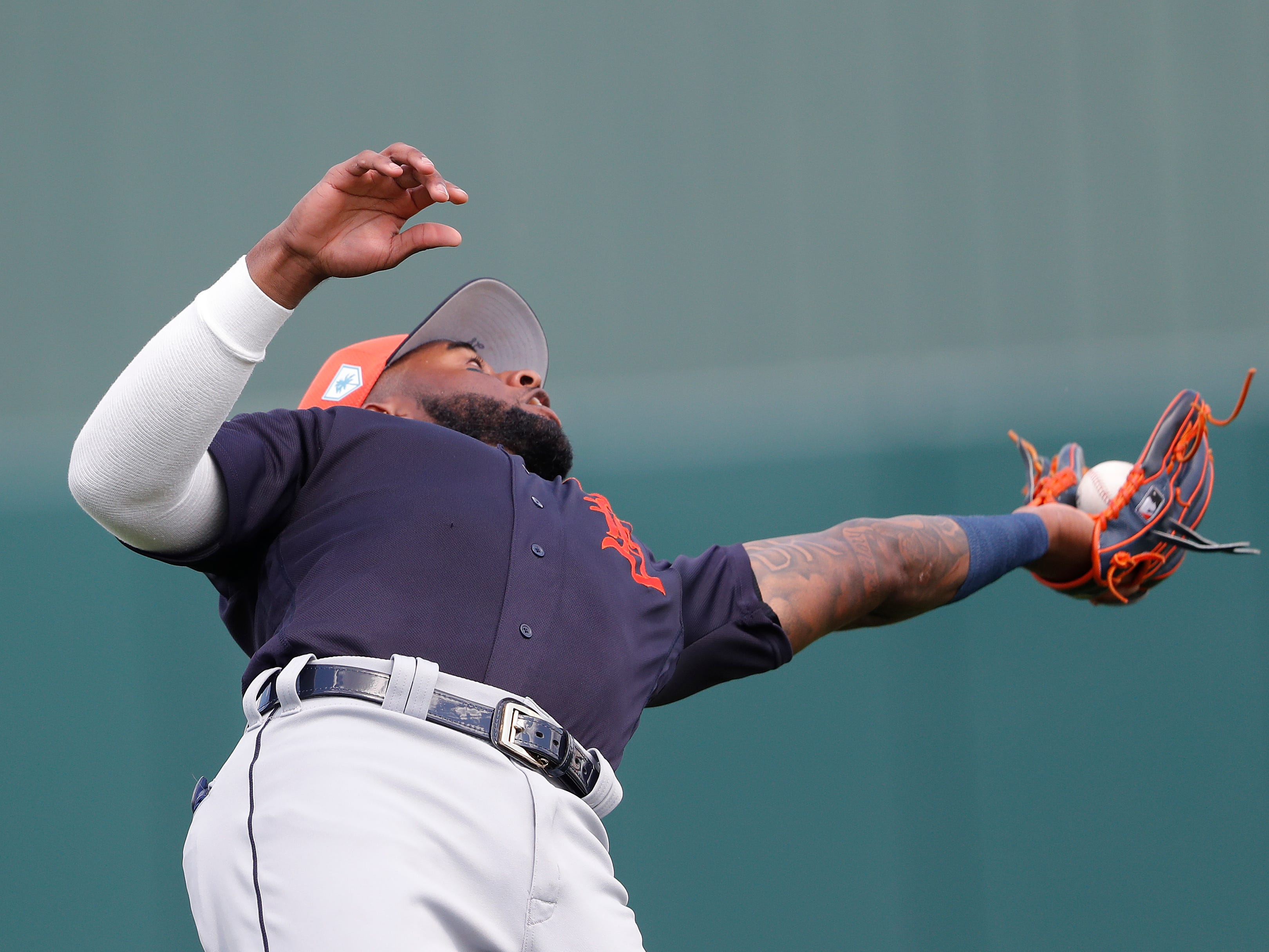 Detroit Tigers shortstop Niko Goodrum (28) catches pop up from Minnesota Twins Mitch Garver in the fourth inning of a spring training baseball game Monday, March 11, 2019, in Fort Myers, Fla.