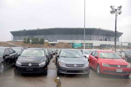 Cars are stored in the parking lot of the Pontiac Silverdome in Pontiac , Michigan on November 30, 2017.  Federal prosecutors have charged Romane Porter, 42, of Farmington Hills and Daniel Onorati, 41, of Eastpointe with conspiring to steal dozens of Volkswagen and Audi vehicles stored at the Pontiac Silverdome parking lot.