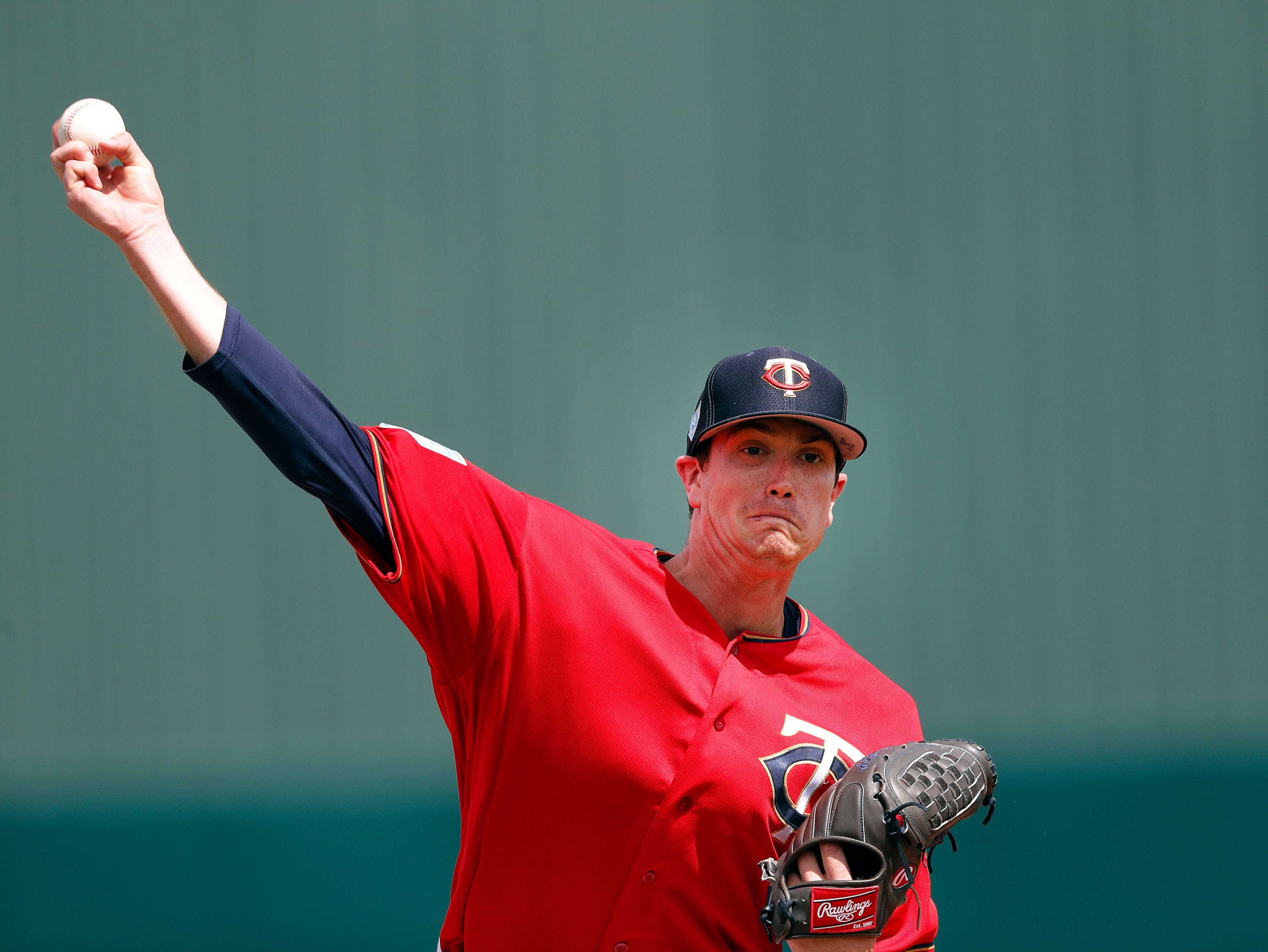 Minnesota Twins starting pitcher Kyle Gibson (44) warms up before facing Detroit Tigers in a spring training baseball game Monday, March 11, 2019, in Fort Myers, Fla.