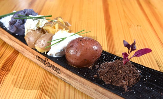 One of  Cork & Gabel's favorite dishes is named the Life of a Potato, a boiled potato, smashed and mashed potato, editable earth, bacon powers, boursin cheese, and chive sour cream, at the Corktown restaurant on Thursday, March 7, 2019.