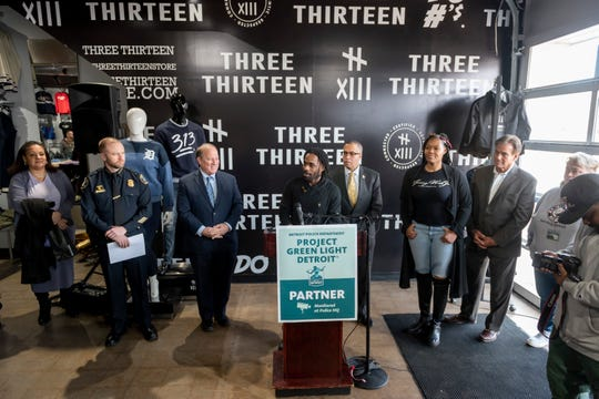 """Clement """"Fame"""" Brown Jr., Founder of Three Thirteen, center, speaks during a press conference inside the store on Livernois, in Detroit, March 11, 2019.  The clothing store recently became the 500th business to adopt the Project Green Light community safety program."""