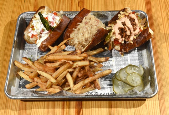 The Sausage Sandwich Sampler which has a Irish Banger, an Italian Sausage, and a German Brat at the Corktown restaurant on Thursday, March 7, 2019.