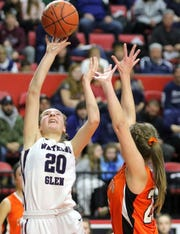 Adrienna Solomon of Watkins Glen takes a shot in front of Cooperstown's Piper Seamon during a Class C girls basketball state quarterfinal Sunday at Floyd L. Maines Veterans Memorial Arena in Binghamton.