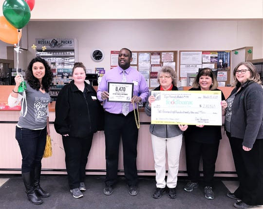 The Food Bank of the Southern Tier stopped at the Tops Friendly Market in Southport on Monday as part of a day-long tour to wrap up its annual Check Out Hunger campaign.