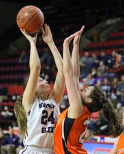 Watkins Glen's Taylor Kelly takes a shot as Cooperstown's Natalie Fountain defends during a Class C girls basketball state quarterfinal Sunday at Floyd L. Maines Veterans Memorial Arena in Binghamton.