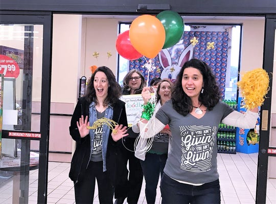 Natasha Thompson, front, president and CEO of the Food Bank of the Southern Tier, and other food bank  representatives stop at the Tops Friendly Market in Southport on Monday to wrap up the annual Check Out Hunger campaign.