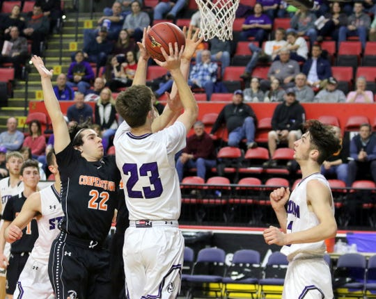 Cameron Osborne of Unadilla Valley takes a shot as Cooperstown's Ben Tafuro defends during a Class C boys basketball state quarterfinal Sunday at Floyd L. Maines Veterans Memorial Arena in Binghamton. At right is Unadilla Valley's Levi Rifanburg.