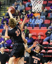 Noah Lifgren of Cooperstown blocks a shot from Unadilla Valley's Andrew Jackson during a Class C boys basketball state quarterfinal Sunday at Floyd L. Maines Veterans Memorial Arena in Binghamton.