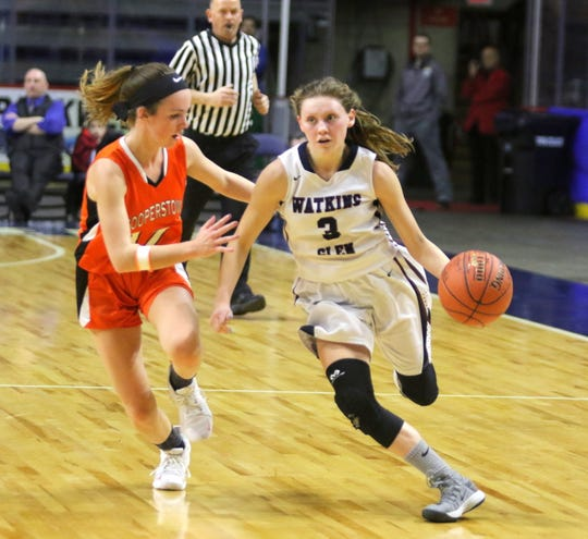 Watkins Glen's Hannah Morse drives past Cooperstown's Kate Trosset during a Class C girls basketball state quarterfinal Sunday at Floyd L. Maines Veterans Memorial Arena in Binghamton.