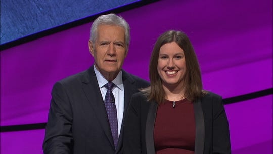 "Lindsey Gelder Piesz poses with Alex Trebek after appearing on a 2018 episode of ""Jeopardy!"" Trebek announced last week that he'd been diagnosed with stage 4 pancreatic cancer."