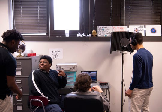 "R.C. Lehman, center, runs the laptop mixing studio as his students, from left, BeeJay Bowling, Andrew Schaeffer, and Marcus Johnson take turns at the microphone at Harwood Career Preparatory High School Monday morning. The ""Hip-Hop Homeroom"" is up for a Leadership Evansville Celebration of Leadership Award later this week."