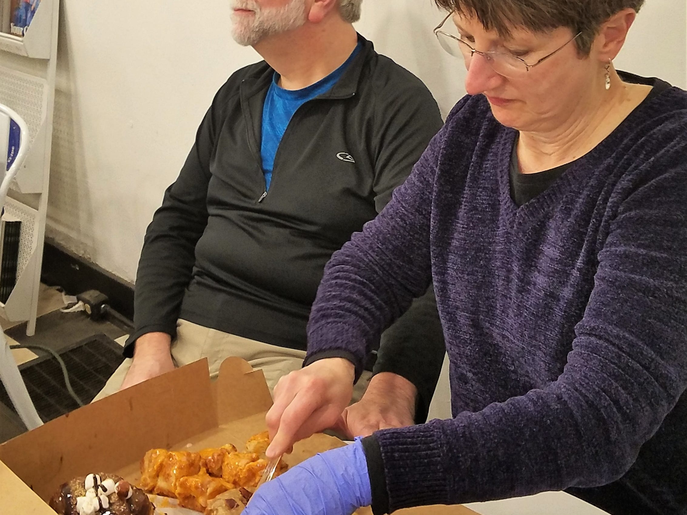 Chef Cheryl Mochau cuts up goodies from Parlor Doughnuts on an Evansville Culinary Tour.