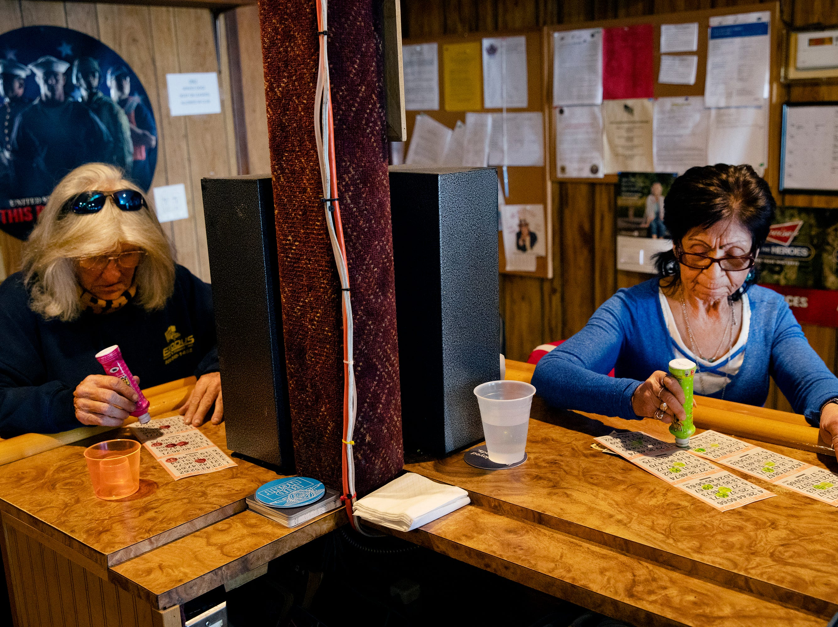 Joy Waters, left, and Virginia Serrano daub their cards during the Sunday afternoon bingo game at the George Beach Post No. 4 of the American Legion on March 10. Waters has been a member for 25 years and Serrano for 13 years.