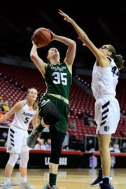 Colorado State's Lore Devos goes for a shot during the Rams' 62-59 loss to Utah State in the first round of the Mountain West tournament on Sunday in Las Vegas.