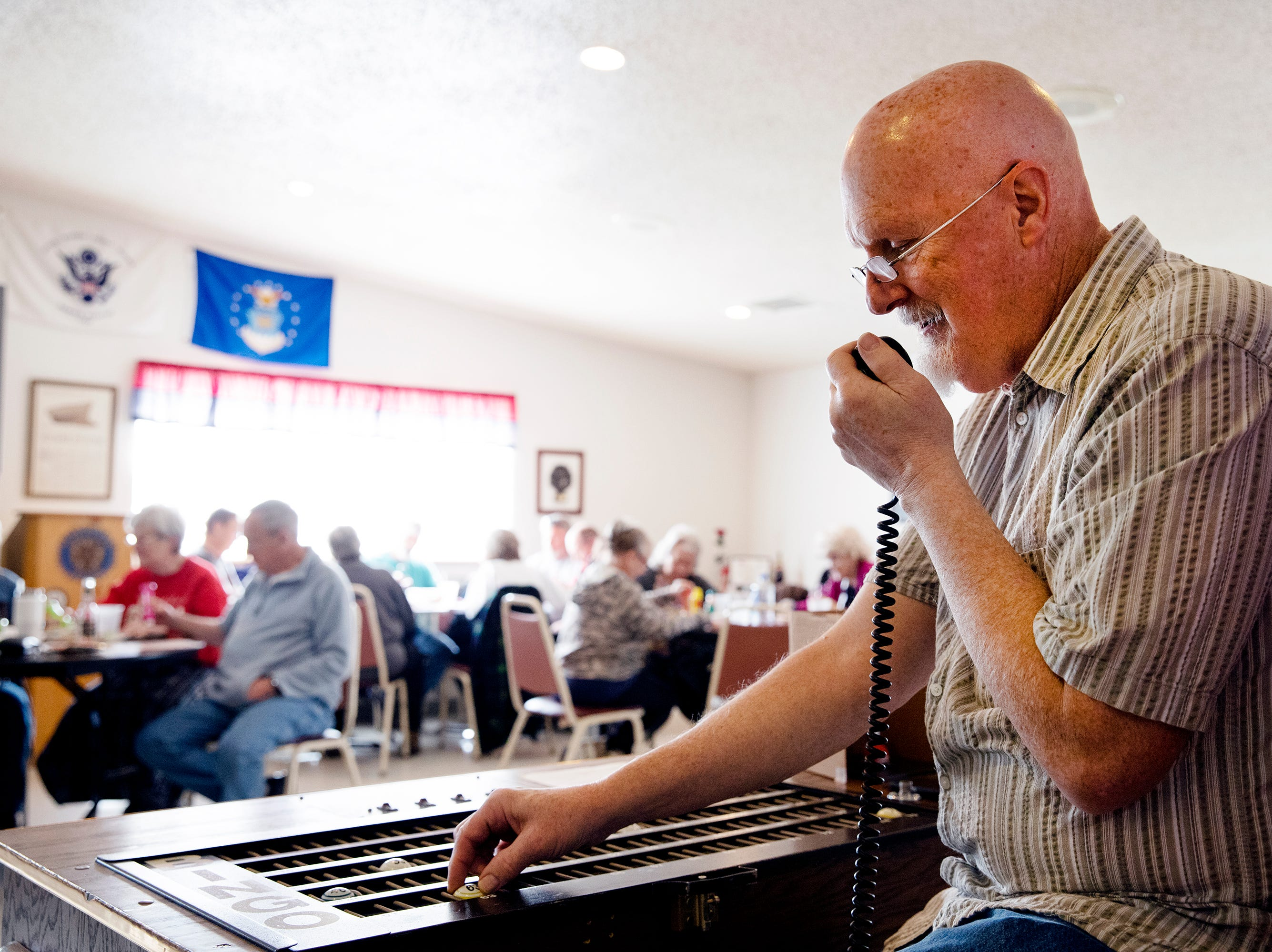 Gary Bishop calls a number during the weekly bingo game at the George Beach Post No. 4 of the American Legion on March 10. Bishop volunteers every other week as the caller for the games.