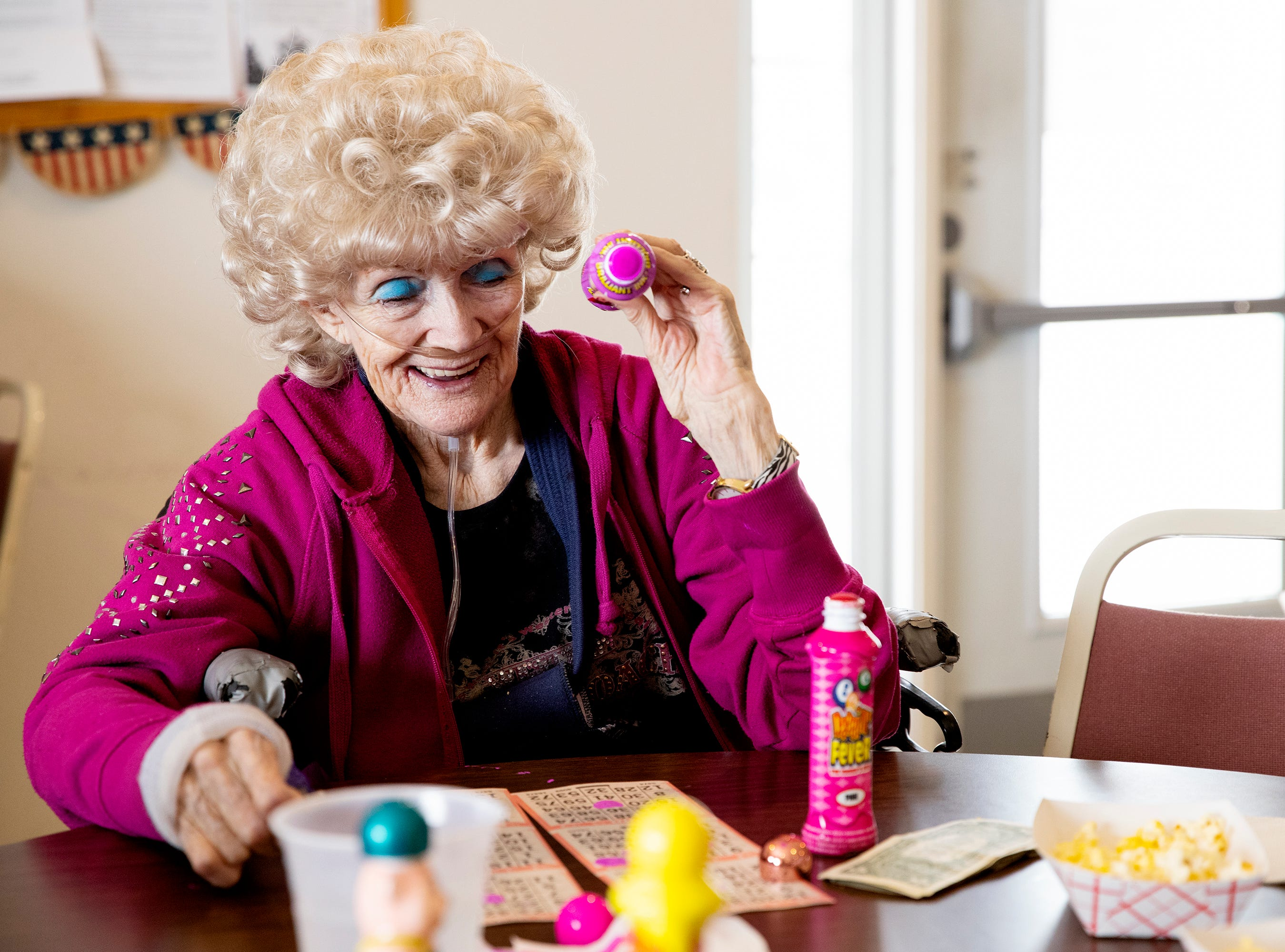Beverly Anderson laughs as she plays bingo at the George Beach Post No. 4 of the American Legion on March 10. Anderson has been a member of the Legion for at least 50 years and attends the bingo game almost every week.
