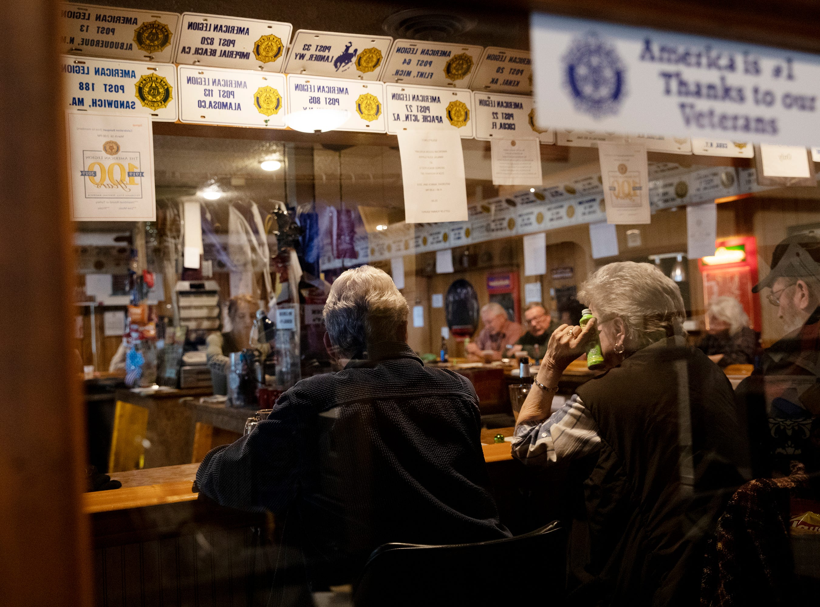 Attendees gather at the bar of the George Beach No. 4 Post of the American Legion for the weekly Sunday afternoon bingo.