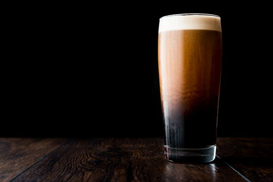 The nitrogen infusion creates a beautiful cascading foam effect in a pint of Left Hand's Milk Stout Nitro.