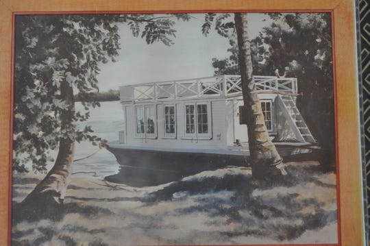 This photo shows what the house looked like when it was a houseboat in the 1930s.