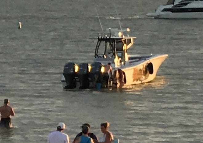 A photo from Fort Myers Beach shows a boat moments before a woman was fatally injured when she was hit by the craft's propellor. The Florida Fish and Wildlife Commission is investigating.