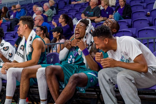 FSW's Charles Manning Jr. shares a laugh with his teammates during a game earlier this season.