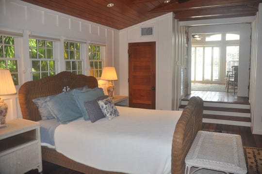 The master bedroom on The Ark has a spacious bedroom and a sitting room overlooking the water.