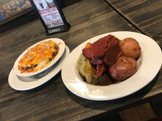 Two Irish staples on the menu at Kitty O'Reilly's Irish Pub in Sturgeon Bay are corned beef and cabbager with red potatoes and root vegetables, foreground, and shepherd's pie with beef and root vegetables in the filling.