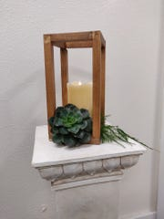 An example of what the final wood centerpieces will look like after being decorated by My Viola Floral Studio.
