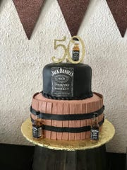 Smooth and textured fondant complete the look for this Jack Daniels-themed cake by Laling's Cakes.