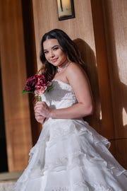 Model: Gianna Sgambelluri  Gown, bouquet: Paradise Weddings  Location: Lotte Hotel Guam  Make-up: Deryan Nisperos  of Salina's BeautiWorks  Hair: Sean Sapp of Salina's BeautiWorks