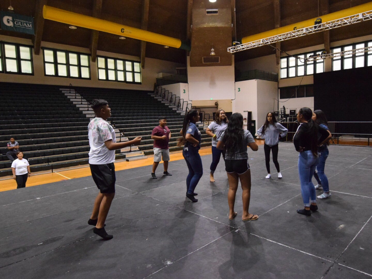 Cultural dancers from Tinian Jr./Sr. High School practice their CHamoru Language Competition performance for the upcoming 51st University of Guam Charter Day at the UOG Calvo Field House, March 11, 2019.