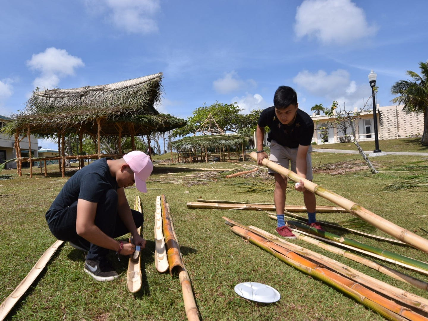 Michael Kasala, left, and Tristan Castino  team up to construct their Society of American Military Engineers Student Chapter hut for the University of Guam's annual Charter Day on the UOG campus, March 11, 2019.