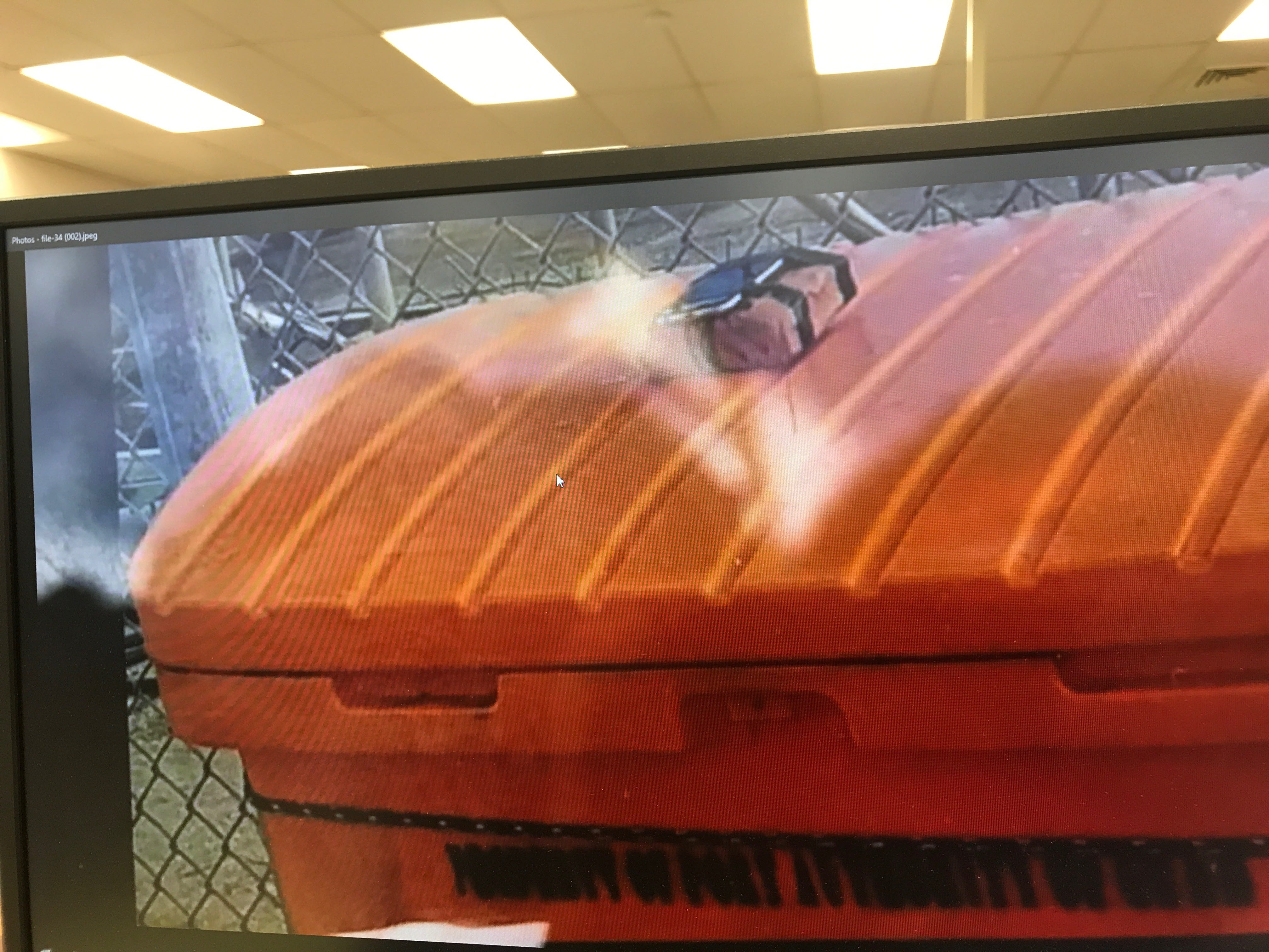 This photo displayed on a computer screen of an object found on top of what appears to be a trash container has been making the social media rounds after local and federal authorities reported a possible live ordnance discovered at the Agat Marina. Guam Fire Department spokesman Kevin Reilly confirmed this photo is what authorities found Tuesday, March 12, 2019.