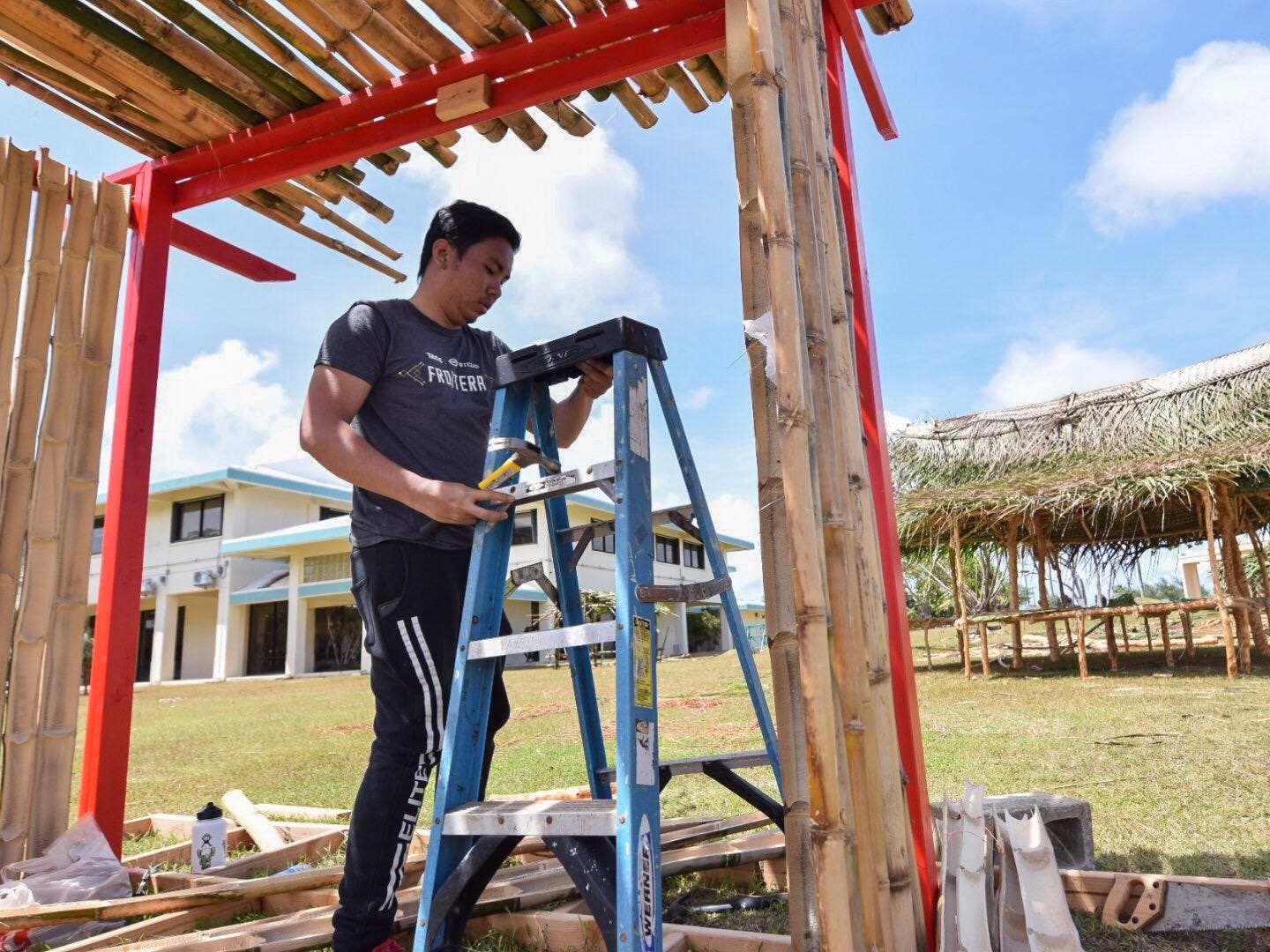 Nilo Espinoza, a Society of American Military Engineers Student Chapter member, gets to work on his club's hut in preparation for the 51st University of Guam Charter Day on the UOG campus, March 11, 2019.