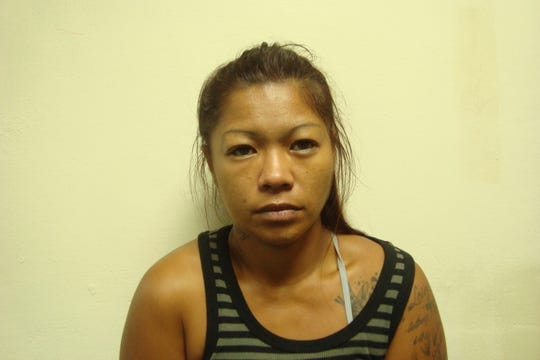 Angelica Taisacan, 31, is accused of attempting to cash a fake check of $936.64 at the Payless in Dededo.
