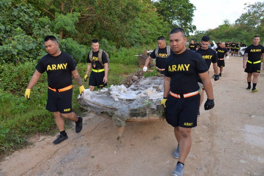 "Members of the 1-294th Infantry Regiment, Guam Army National Guard's ""Chamorri Battalion,"" removed over 5,000 pounds of trash from Dededo village and the Okkodo Pipeline on March 10."