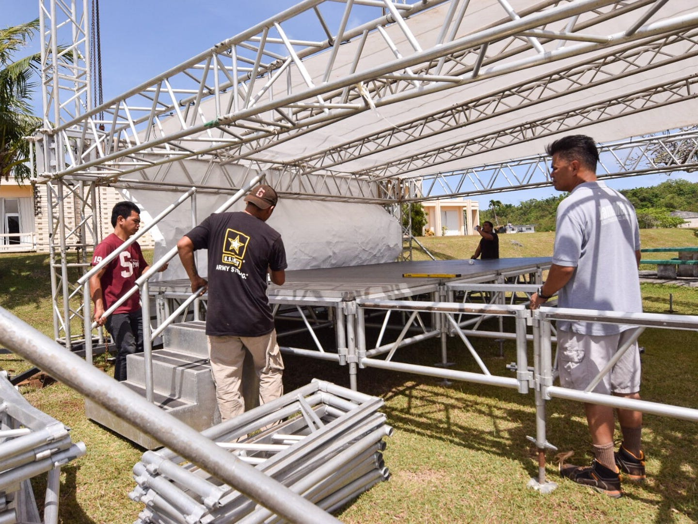 The Jamzmedia crew sets up the stage for the 51st University of Guam Charter Day at the UOG campus in Mangilao, March 11, 2019.