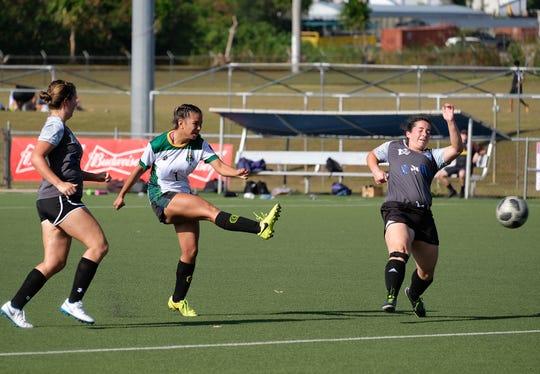 Elisha Benavente (#1) scored four goals for the Lady Tritons.