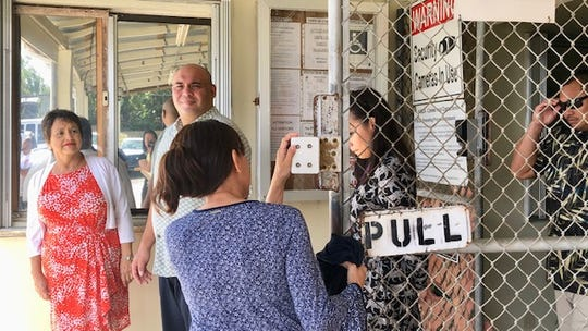 Gov. Lou Leon Guerrero and Lt. Gov. Josh Tenorio exit one of the guarded and aging facilities of the Department of Youth Affairs in Mangilao Monday morning.