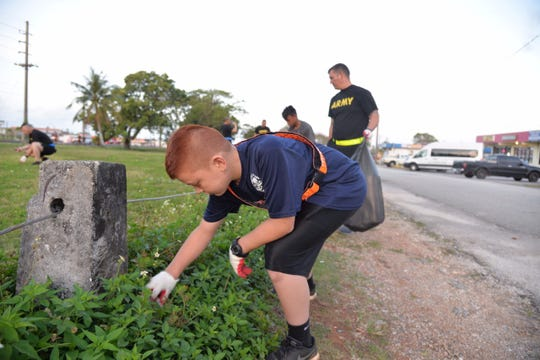 "Members of the 1-294th Infantry Regiment, Guam Army National Guard's ""Chamorri Battalion,"" and families joined in the cleanup on March 10. In addition to the trash removal, over 20 students received credit for service learning hours."