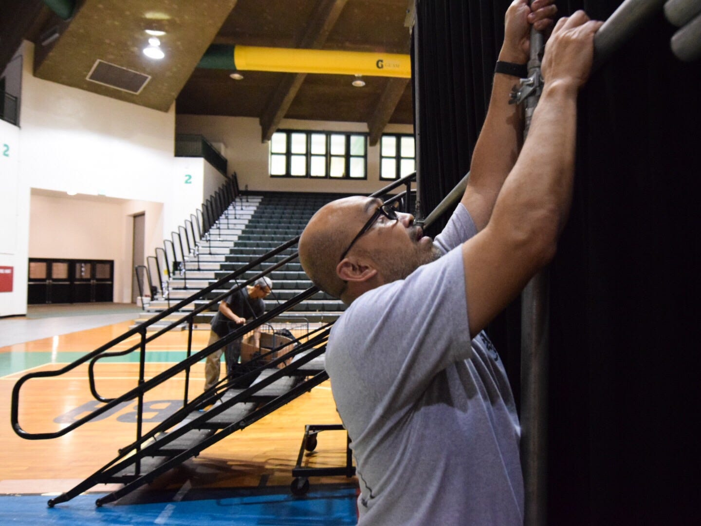 Maintenance worker Jude Camemo makes adjustments to the University of Guam Calvo Field House stage in preparation for the 51st University of Guam Charter Day at the UOG Calvo Field House, March 11, 2019.