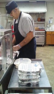 "Frank Rucks helps get ""Meals on Wheels"" lunches ready for delivery. Roughly 90 people get a meal delivery every weekday afternoon in Henderson County, but many more are on the waiting list."