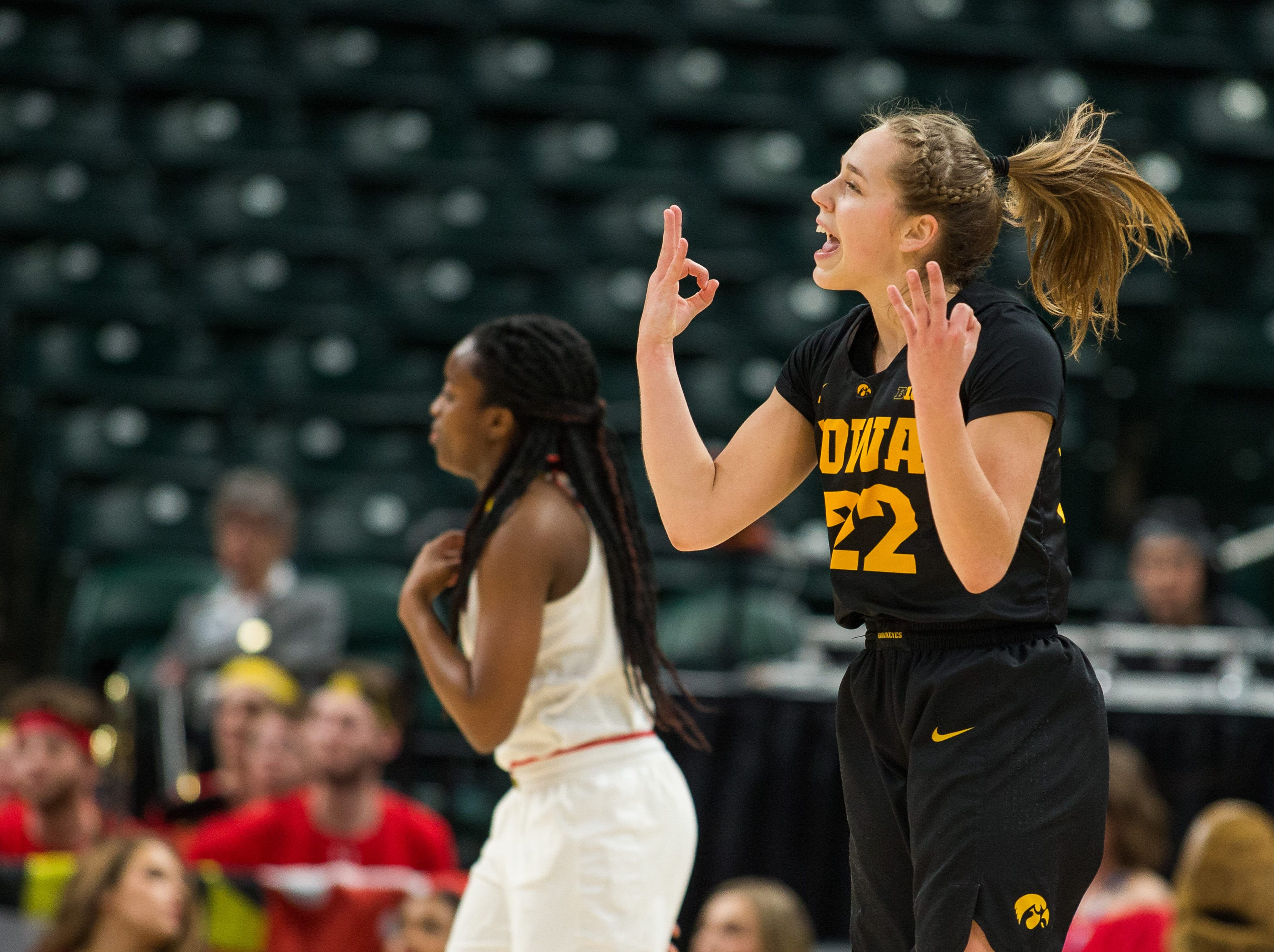 Iowa Hawkeyes guard Kathleen Doyle (22) reacts to a made three point basket in the first half against the Maryland Terrapins in the women's Big Ten Conference Tournament at Bankers Life Fieldhouse.