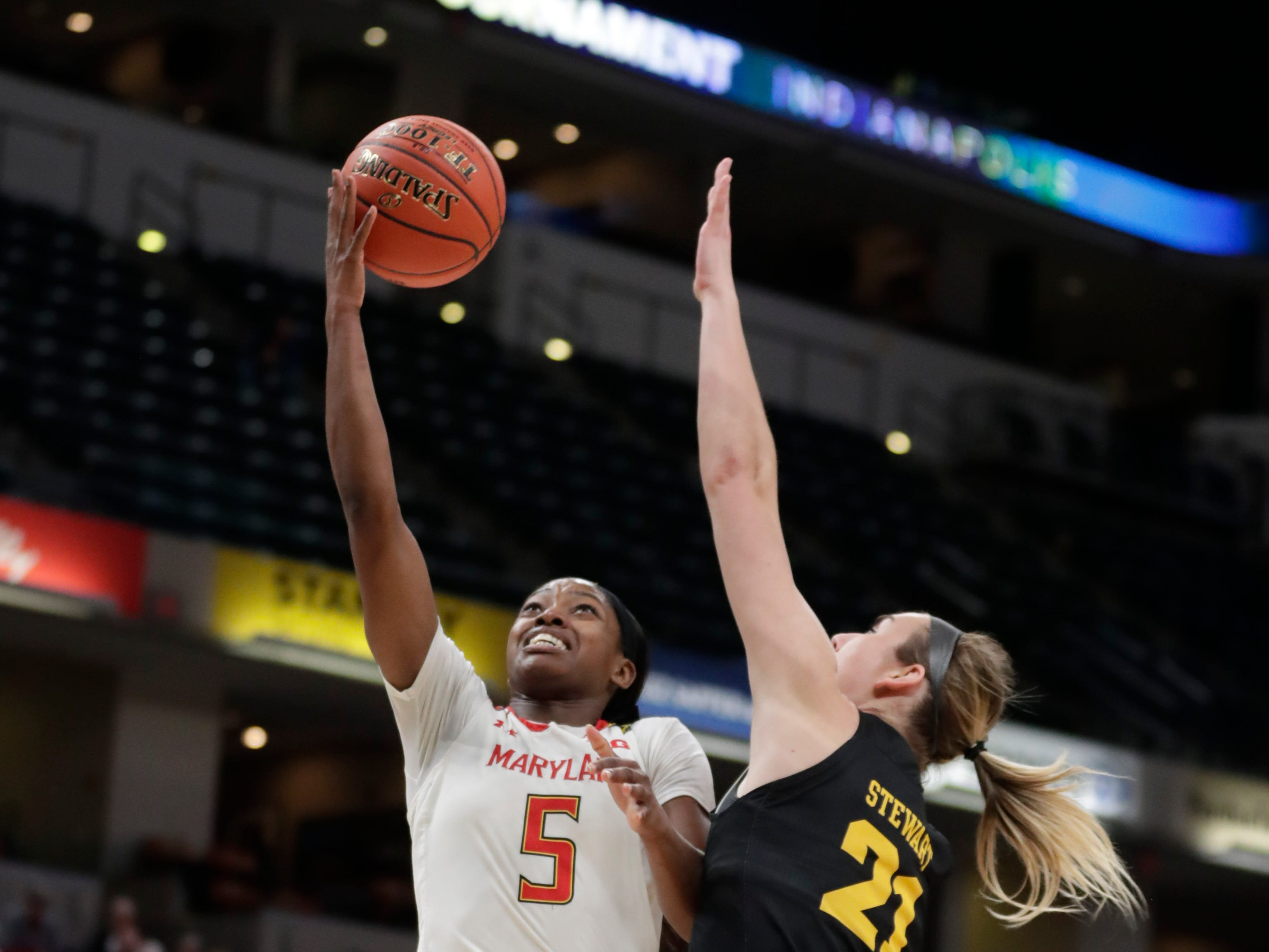 Maryland guard Kaila Charles (5) shoots over Iowa forward Hannah Stewart (21) in the first half of an NCAA college basketball championship game at the Big Ten Conference women's tournament in Indianapolis, Sunday, March 10, 2019.