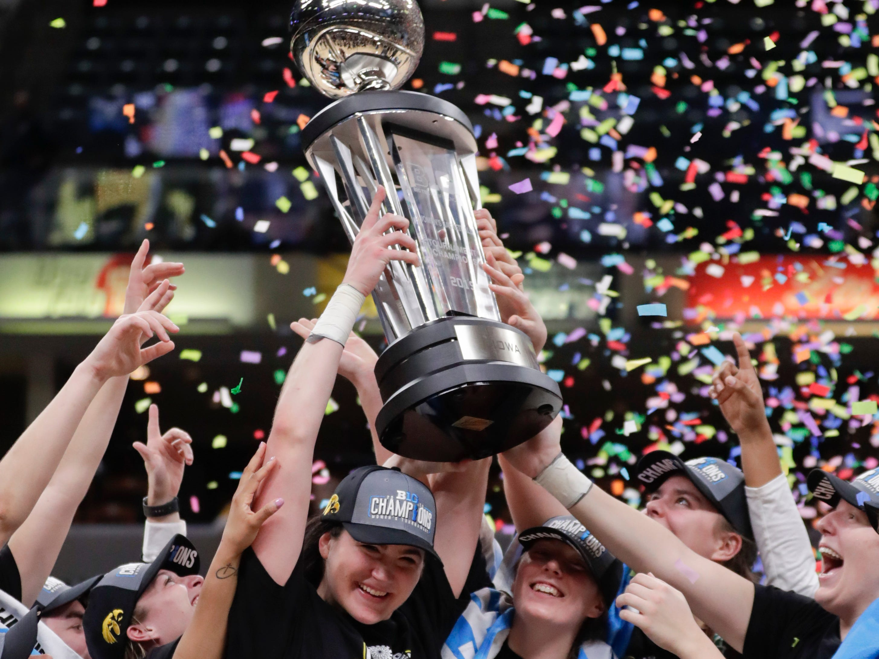 Iowa forward Megan Gustafson (10) celebrates with the trophy following an NCAA college basketball championship game at the Big Ten Conference tournament against the Maryland in Indianapolis, Sunday, March 10, 2019. Iowa defeated Maryland 90-76.