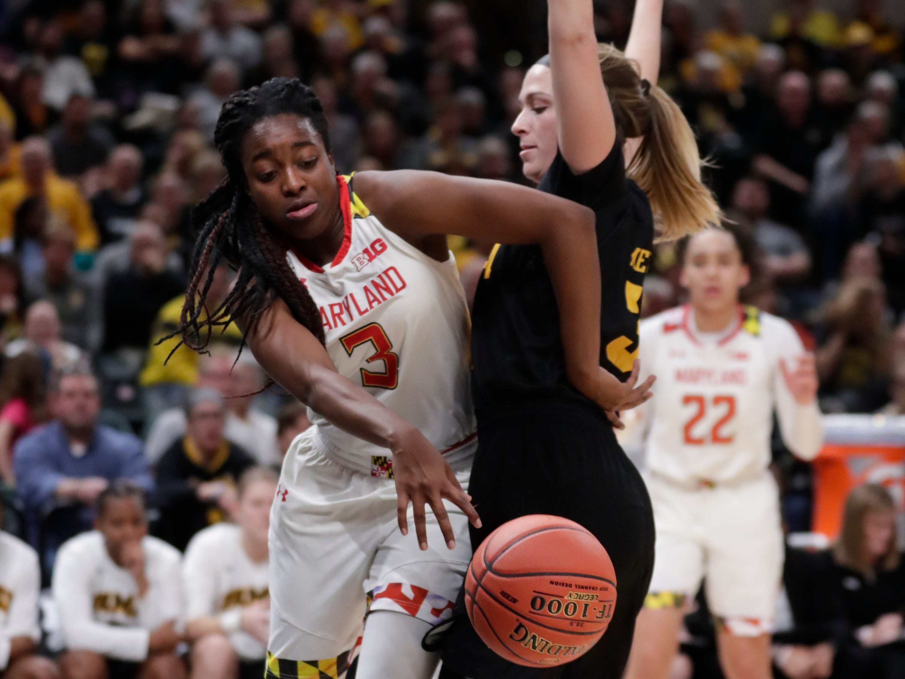 Maryland guard Channise Lewis (3) gets pushed out-of-bounds by Iowa guard Makenzie Meyer (3) in the first half of an NCAA college basketball championship game at the Big Ten Conference tournament in Indianapolis, Sunday, March 10, 2019.
